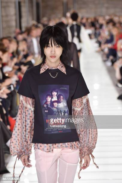 A model walks the runway at the Louis Vuitton Spring Summer 2018 fashion show during Paris Fashion Week on October 3 2017 in Paris France