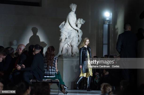A model walks the runway at the Louvre's Museum during the Louis Vuitton show as part of the Paris Fashion Week Womenswear Fall/Winter 2017/2018 on...