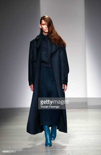 A model walks the runway at the Lucas Nascimento show at London Fashion Week AW14 at Somerset House on February 15 2014 in London England