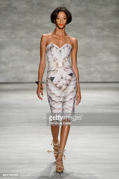 Model walks the runway at the Luis Antonio fashion show during Mercedes-Benz Fashion Week Spring 2015 at The Pavilion at Lincoln Center on September...