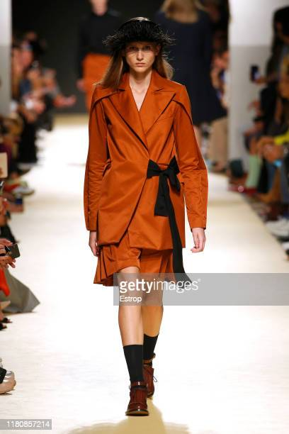 A model walks the runway at the Luis Carvalho fashion show during Lisboa Fashion Week 'ModaLisboa' S/S 2020 on October 13 2019 in Lisboa Portugal