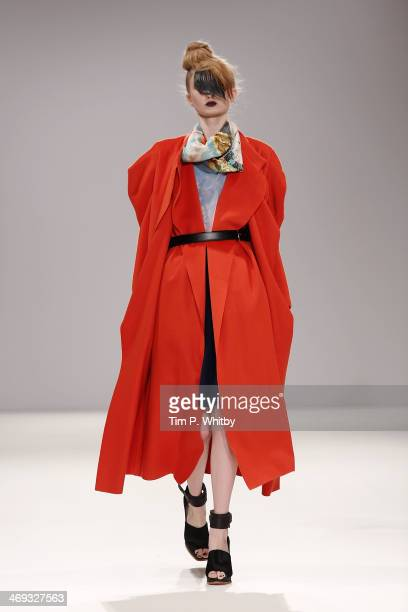 Model walks the runway at the Lulu Liu show at the Fashion Scout venue during London Fashion Week AW14 at Freemasons Hall on February 14, 2014 in...