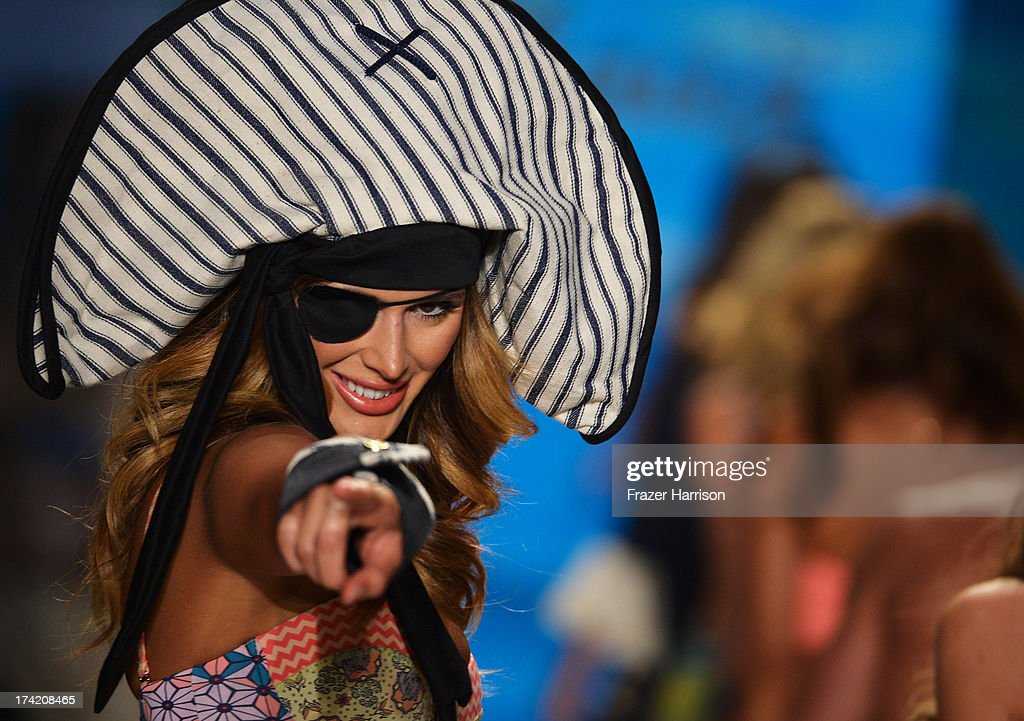 A model walks the runway at the Maaji Swimwear show during Mercedes-Benz Fashion Week Swim 2014 at Cabana Grande at the Raleigh on July 21, 2013 in Miami, Florida.