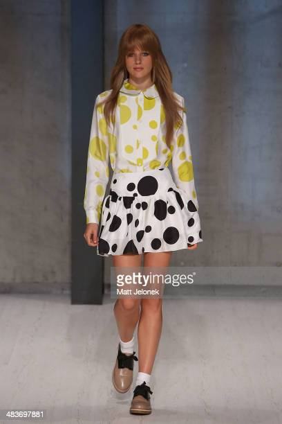 A model walks the runway at the Macgraw show at MercedesBenz Fashion Week Australia 2014 at on April 10 2014 in Sydney Australia