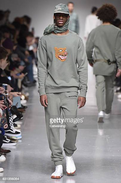 A model walks the runway at the Maharishi Autumn Winter 2017 fashion show during London Menswear Fashion Week on January 8 2017 in London United...