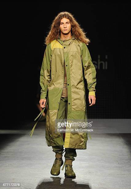 Model walks the runway at the Maharishi show during The London Collections Men SS16 at The Old Sorting Office on June 14, 2015 in London, England.
