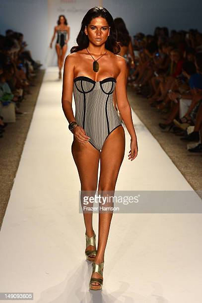 Model walks the runway at the MAIO Swim By Monica Wise show during Mercedes-Benz Fashion Week Swim 2013 at The Raleigh on July 22, 2012 in Miami...