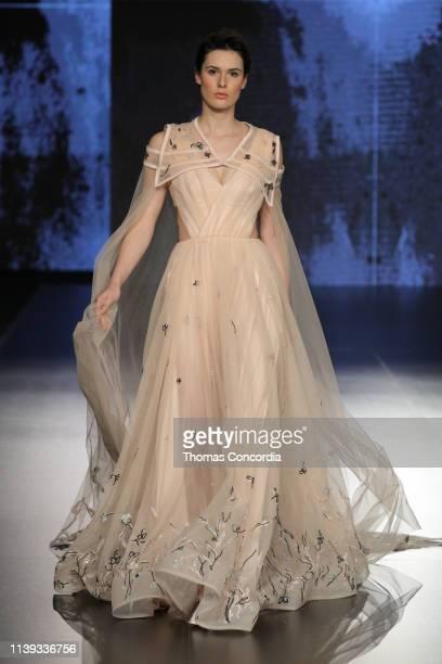 A model walks the runway at the Mais Al Fatleh show during Jordan Fashion Week 019 at the Kempinski Amman on March 30 2019 in Amman Jordan