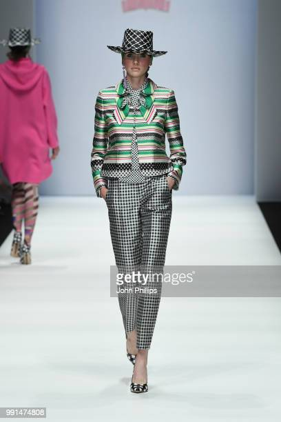A model walks the runway at the Maison Common show during the Berlin Fashion Week Spring/Summer 2019 at ewerk on July 4 2018 in Berlin Germany
