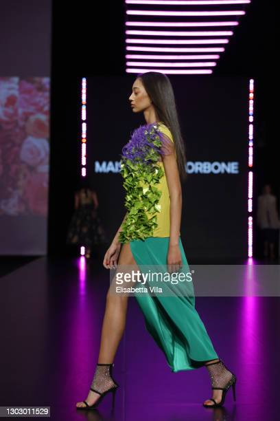 """Model walks the runway at the Maison Luigi Borbone """"Il Fiore Che Non Ho Mai Colto"""" Fashion Show during the Altaroma 2021 on February 19, 2021 in..."""