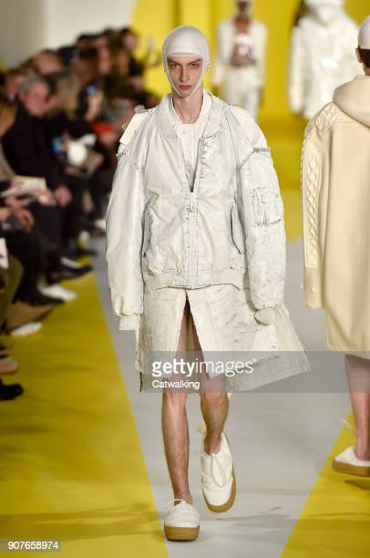A model walks the runway at the Maison Margiela Autumn Winter 2018 fashion show during Paris Menswear Fashion Week on January 19 2018 in Paris France