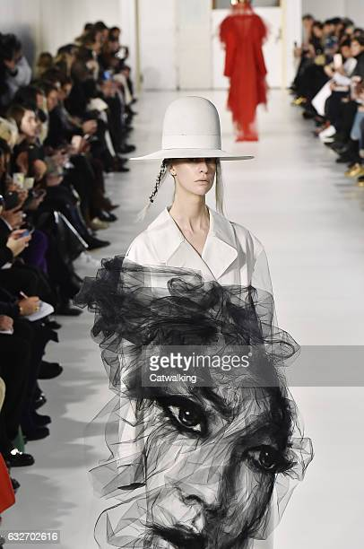 Model walks the runway at the Maison Margiela Spring Summer 2017 fashion show during Paris Haute Couture Fashion Week on January 25, 2017 in Paris,...