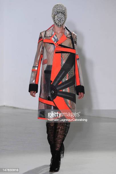 A model walks the runway at the Maison Martin Margiela Autumn Winter 2012 fashion show during Paris Haute Couture Fashion Week on July 4 2012 in...