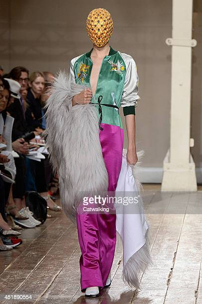 Model walks the runway at the Maison Martin Margiela Autumn Winter 2014 fashion show during Paris Haute Couture Fashion Week on July 9, 2014 in...