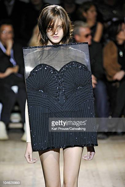 A model walks the runway at the Maison Martin Margiela fashion show during Paris Fashion Week on October 1 2010 in Paris City
