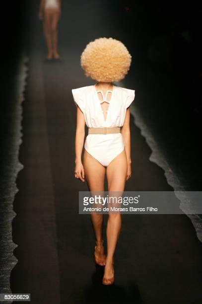 Model walks the runway at the Maison Martin Margiela fashion show during Paris Fashion Week on September 29, 2008 in Paris, France.