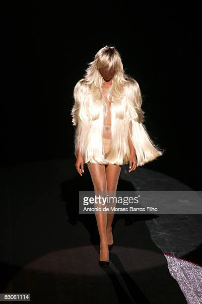 A model walks the runway at the Maison Martin Margiela fashion show during Paris Fashion Week on September 29 2008 in Paris France