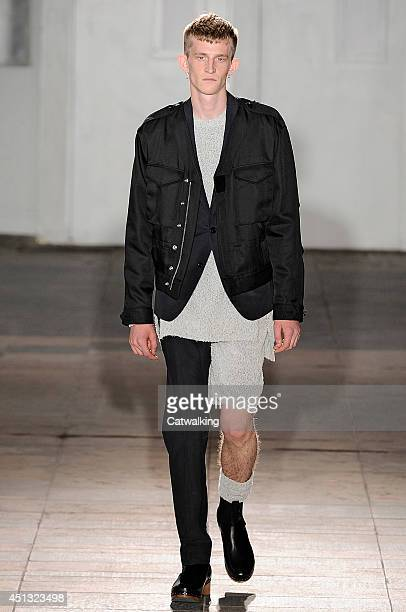 A model walks the runway at the Maison Martin Margiela Spring Summer 2015 fashion show during Paris Menswear Fashion Week on June 27 2014 in Paris...