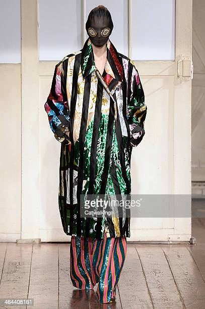 Model walks the runway at the Maison Martin Margiela Spring Summer 2014 fashion show during Paris Haute Couture Fashion Week on January 22, 2014 in...