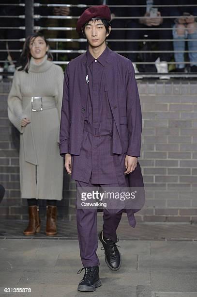 Model walks the runway at the Maison Mihara Yasuhiro Autumn Winter 2017 fashion show during London Menswear Fashion Week on January 8, 2017 in...