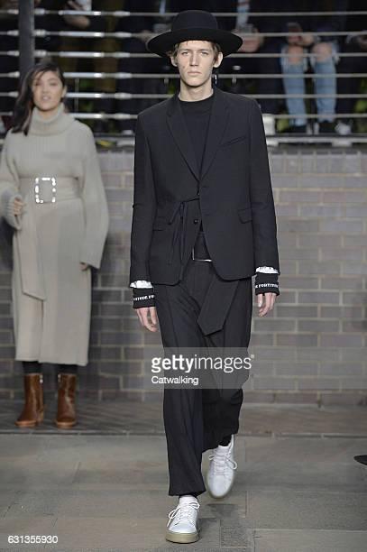A model walks the runway at the Maison Mihara Yasuhiro Autumn Winter 2017 fashion show during London Menswear Fashion Week on January 8 2017 in...