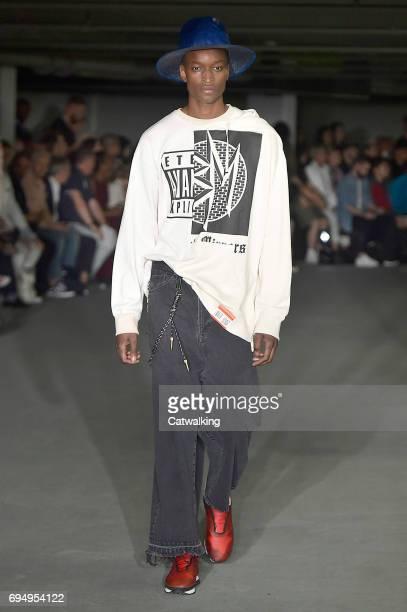 A model walks the runway at the Maison MIHARA YASUHIRO Show Spring Summer 2018 fashion show during London Menswear Fashion Week on June 11 2017 in...