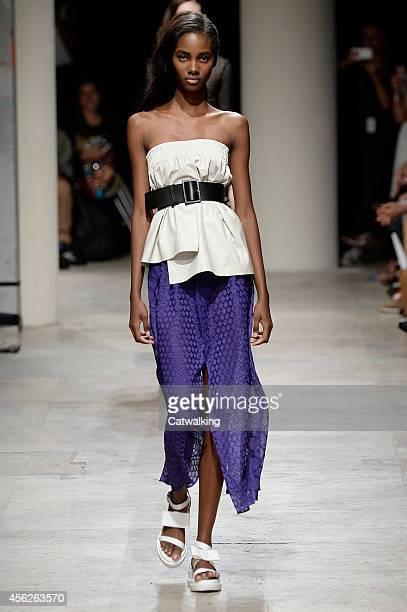 A model walks the runway at the Maison Rabih Kayrouz Spring Summer 2015 fashion show during Paris Fashion Week on September 28 2014 in Paris France