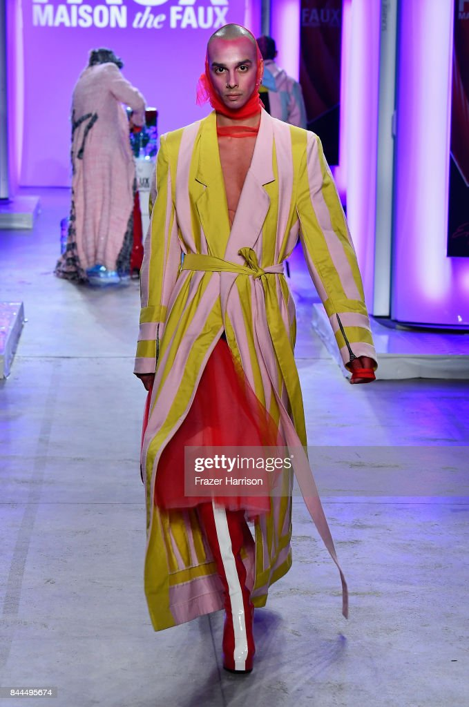 A model walks the runway at the Maison The Faux fashion show ...