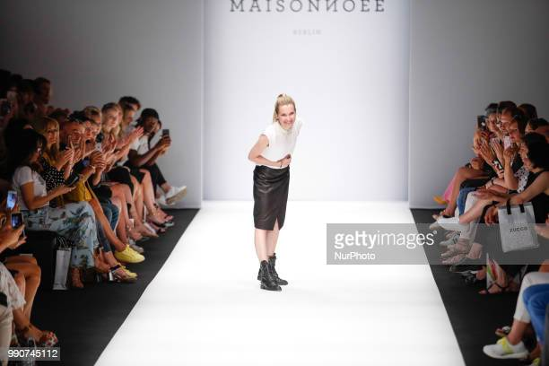 A model walks the runway at the Maisonnoee show during the Berlin Fashion Week Spring/Summer 2019 at ewerk on July 3 2018 in Berlin Germany