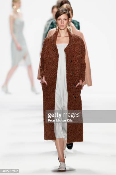 A model walks the runway at the Malaikaraiss Show during MercedesBenz Fashion Week Autumn/Winter 2014/15 at Brandenburg Gate on January 15 2014 in...