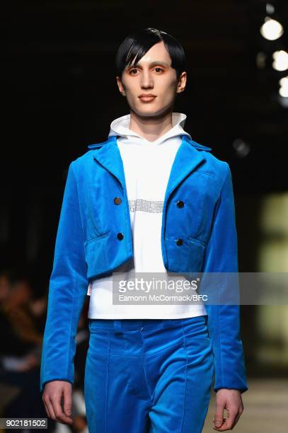 Model walks the runway at the MAN - Art School show during London Fashion Week Men's January 2018 at Old Selfridges Hotel on January 7, 2018 in...