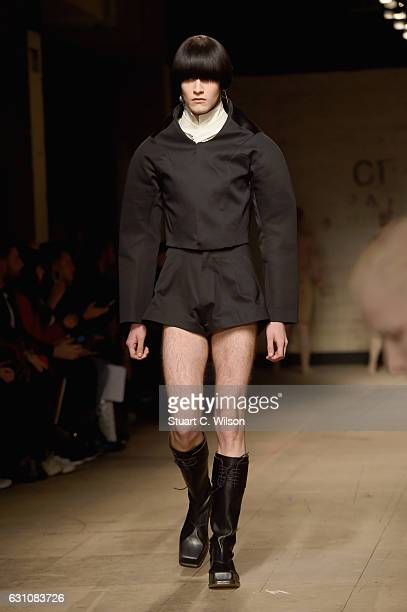 Model walks the runway at the MAN - Charles Jeffrey Loverboy show during London Fashion Week Men's January 2017 collections at Topman Show Space on...