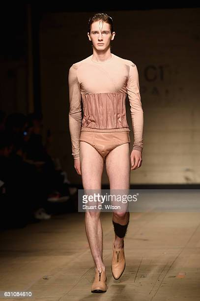 Model walks the runway at the MAN - Feng Chen Wang show during London Fashion Week Men's January 2017 collections at Topman Show Space on January 6,...