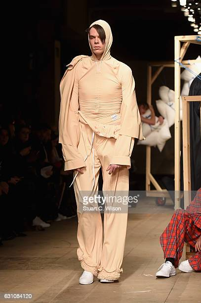 Model walks the runway at the MAN - Per Gotesson show during London Fashion Week Men's January 2017 collections at Topman Show Space on January 6,...