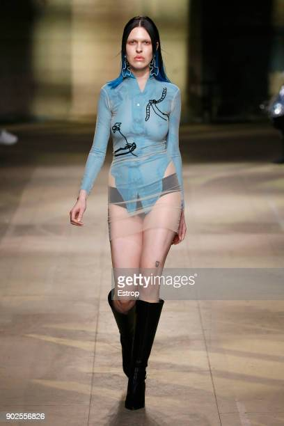 A model walks the runway at the MAN show during London Fashion Week Men's January 2018 at Old Selfridges Hotel on January 7 2018 in London England