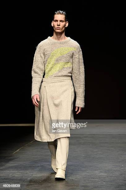 A model walks the runway at the MAN show during The London Collections Men Autumn/Winter 2014 on January 6 2014 in London England