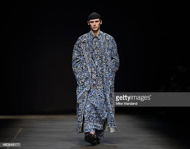 Model walks the runway at the MAN show during The London Collections: Men Autumn/Winter 2014 on January 6, 2014 in London, England.