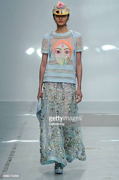 Model walks the runway at the Manish Arora Spring Summer 2015 fashion show during Paris Fashion Week on September 25, 2014 in Paris, France.