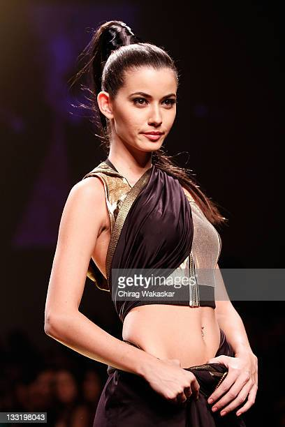 Model walks the runway at the Manish Malhotra show at Lakme India Fashion Week Autumn/Winter 2009 at Grand Hyatt on March 30, 2009 in Bombay, India