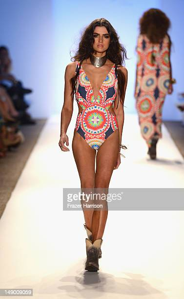 A model walks the runway at the Mara Hoffman show during MercedesBenz Fashion Week Swim 2013 at The Raleigh on July 21 2012 in Miami Beach Florida