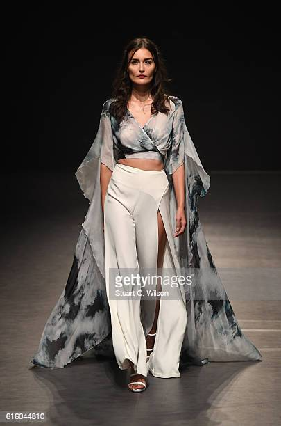 A model walks the runway at the Maram show during Fashion Forward Spring/Summer 2017 at the Dubai Design District on October 21 2016 in Dubai United...