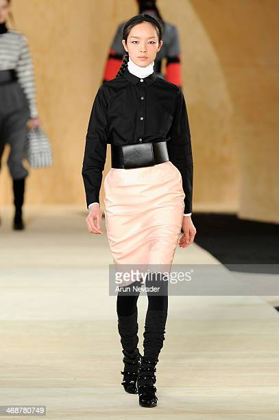 A model walks the runway at the Marc By Marc Jacobs fashion show during MercedesBenz Fashion Week Fall 2014 at Pier 36 on February 11 2014 in New...