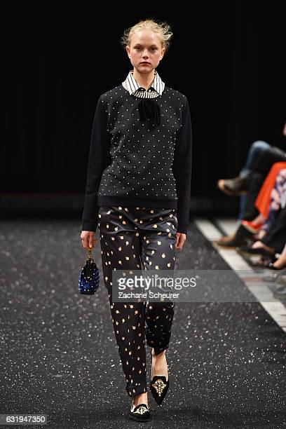 A model walks the runway at the Marc Cain fashion show A/W 2017 on January 17 2017 in Berlin Germany