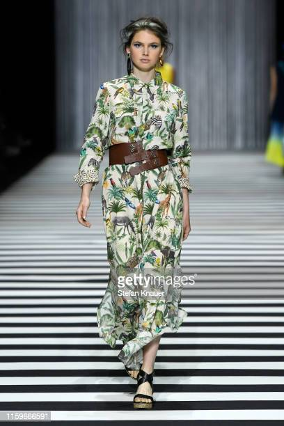 A model walks the runway at the Marc Cain fashion show during the Berlin Fashion Week Spring/Summer 2020 at Velodrom on July 02 2019 in Berlin Germany