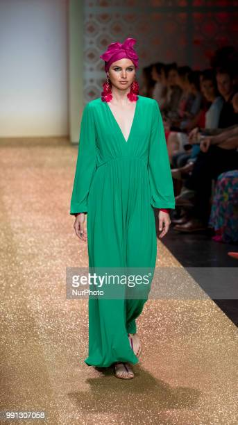 A model walks the runway at the Marc Cain Fashion Show during the Berlin Fashion Week Spring/Summer 2019 at WEEC on July 3 2018 in Berlin Germany