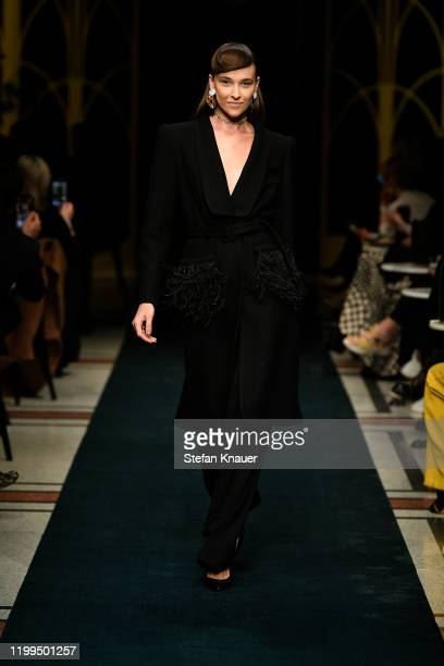 A model walks the runway at the Marc Cain show during Berlin Fashion Week Autumn/Winter 2020 at Deutsche Telekom's representative office on January...
