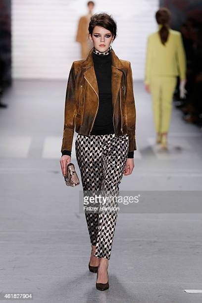 A model walks the runway at the Marc Cain show during the MercedesBenz Fashion Week Berlin Autumn/Winter 2015/16 at Brandenburg Gate on January 20...