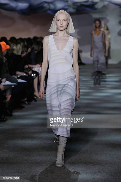 A model walks the runway at the Marc Jacobs fashion show during MercedesBenz Fashion Week Fall 2014 at the New York State Armory on February 13 2014...