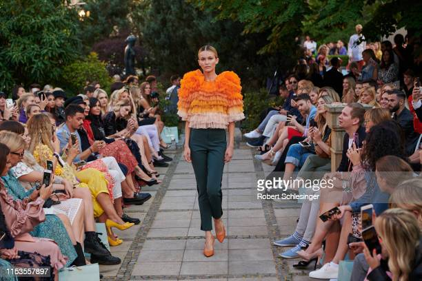A model walks the runway at the Marcel Ostertag show during Berlin Fashion Week Spring/Summer 2020 at Westin Grand Hotel on July 3 2019 in Berlin...