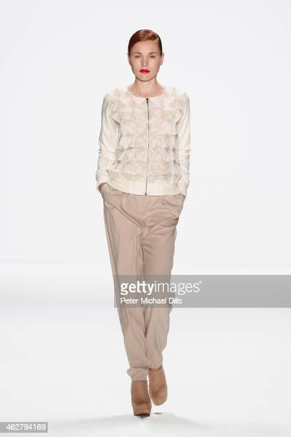 A model walks the runway at the Marcel Ostertag show during MercedesBenz Fashion Week Autumn/Winter 2014/15 at Brandenburg Gate on January 15 2014 in...